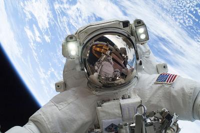 Astronaut Participates in a Spacewalk--Photographic Print
