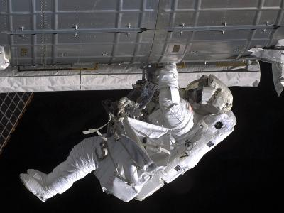 Astronaut Participates in Extravehicular Activity on the International Space Station-Stocktrek Images-Photographic Print