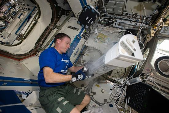 Astronaut Works with the Minus Eighty-Degree Laboratory Freezer for an Iss Experiment-Terry Virts-Photographic Print