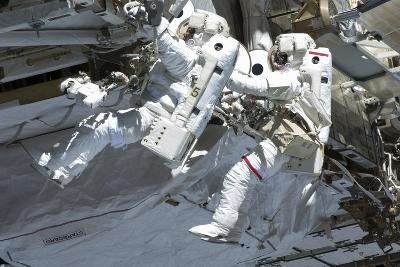 Astronauts Participate in a Spacewalk on the International Space Station--Photographic Print