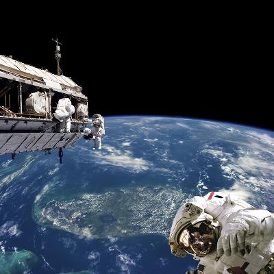 Astronauts Performing Work on Space Station While Orbiting Above Earth-Stocktrek Images-Photographic Print