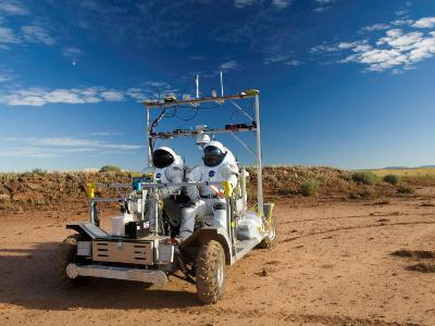 Astronauts test a surface transport vehicle in the Arizona desert--Photographic Print