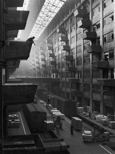 At Brooklyn Army Base Freight Is Lifted from Car to Jutting Loading Platforms-Andreas Feininger-Photographic Print