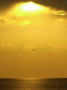 At Sunset a Commerical Jet Makes its Approach to Louis Armstrong New Orleans International Airport