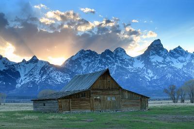 At Sunset, the Teton Range Rises Behind a Historic Barn on Mormon Row-Robbie George-Photographic Print