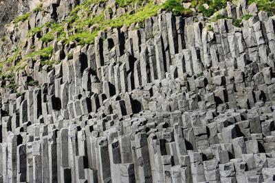 https://imgc.artprintimages.com/img/print/at-the-black-sandy-beach-of-reynisfjara-basalt-colums_u-l-q11xnso0.jpg?p=0