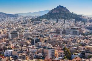 Athens, Attica, Greece. View over Athens from the Acropolis to 277 meter high Mount Lycabettus...