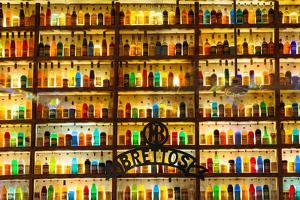 Athens, Attica, Greece. Wall of liquor and liqueur products available in the Brettos shop in the...