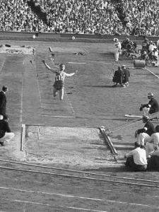 Athlete Competing in Long Jump