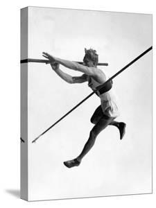 Athlete Doing a Dramatic Pole Vault in Preparation For the 1936 Olympics