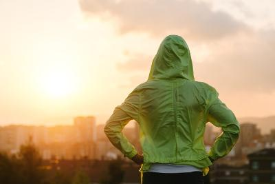 Athlete Looking Sunset over City Skyline after Exercising-Dirima-Photographic Print