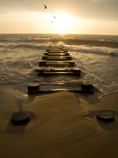 Atlantic Ocean Waves Break Against Pilings at Sunrise-Stephen St^ John-Photographic Print