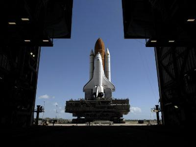 Atlantis Rolls Toward the Open Doors of the Vehicle Assembly Building at Kennedy Space Center--Photographic Print