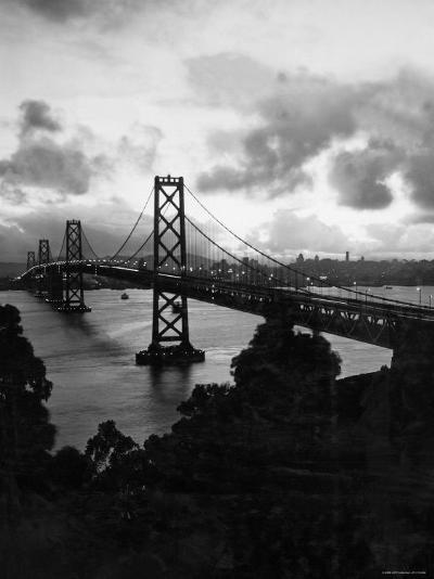 Atmospheric View of the San Francisco Oakland Bay Bridge Viewed from the Oakland Side at Dusk--Photographic Print