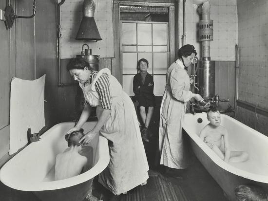 Attendants bathing boys at the Central Street Cleansing Station, London, 1914-Unknown-Photographic Print