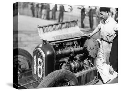 Attilio Marinoni, Chief Mechanic of Scuderia Ferrari, with an Alfa Romeo, 1934