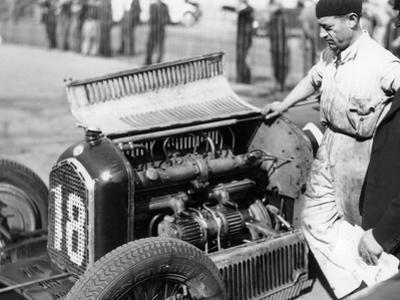 Attilio Marinoni, Chief Mechanic of Scuderia Ferrari, with an Alfa Romeo, 1934