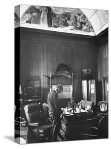 Attorney General Robert F. Kennedy Standing at His Desk