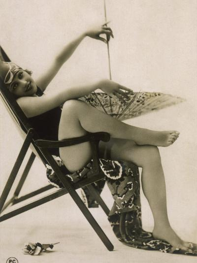 Attractive Woman Posing in Her Swimsuit in a Deckchair, with a Parasol--Photographic Print