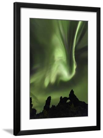 Aurora Storm, Strikingly Bright Northern Lights Dance over Black Lava Formations-Babak Tafreshi-Framed Photographic Print