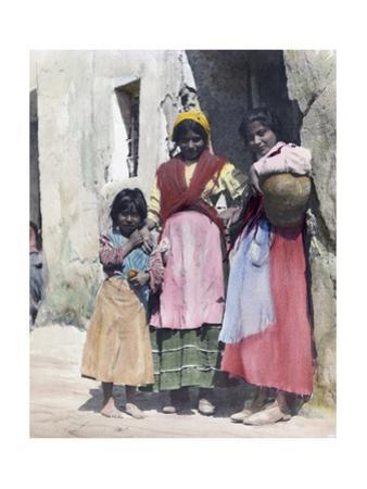 Three Gypsy Girls Stand at the Doorway of a Stone Building by Austin A. Breed