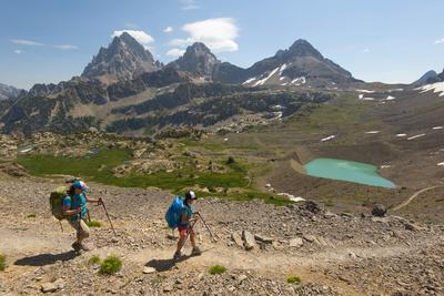 Female Backpackers Hiking Down From Hurricane Pass On Teton Crest Trail In Grand Teton NP, Wyoming