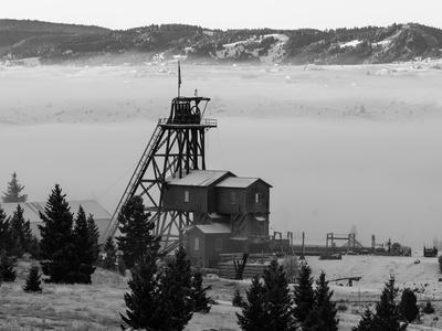 Old Relics Of Historic Mines Rise Above The Clouds In Butte, Montana