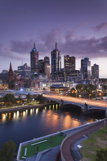 Australia, Victoria, Melbourne, Skyline with River and Bridge at Dusk-Walter Bibikow-Photographic Print