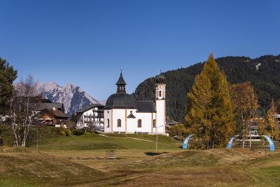 Austria, Tyrol, Seefelder Sattel, Seefeld, Seekirchl in Autumn Against Northern Karwendel Range-Udo Siebig-Photographic Print