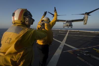 Aviation Boatswain's Mates Direct an MV-22 Osprey on the Flight Deck--Photographic Print