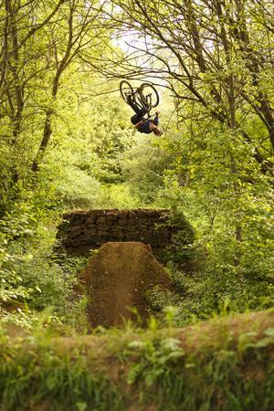 Aalen, Baden-Württemberg, Germany: A Young Freestyle Mt Biker Riding At A Secret Dirt Jump Spot