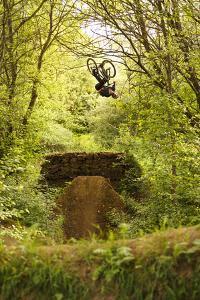 Aalen, Baden-Württemberg, Germany: A Young Freestyle Mt Biker Riding At A Secret Dirt Jump Spot by Axel Brunst