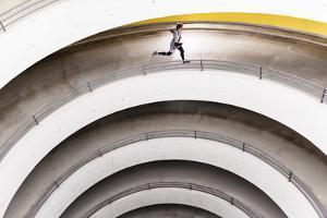 Airport Car Park, Stuttgart, Baden-Württemberg, Germany: A Male Runner Running Through A Car Park by Axel Brunst