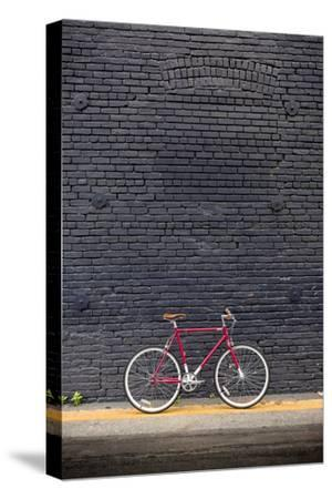 Beverly Hills, Los Angeles, California, USA: A Red Single Speed Bike In Front Of A Black Brick Wall
