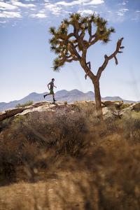 Joshua Tree National Park, California, USA: A Male Runner Running Along Behind A Joshua Tree by Axel Brunst