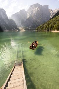Lake Prags, Prags Dolomites, S Tyrol, Italy: People In Rowing Boat Rowing Out From Rental Station by Axel Brunst