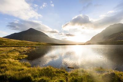 Llyn Idwal (Lake), Snowdonia National Park, Bangor, Wales, UK: Tent At Lake In Early Morning Light