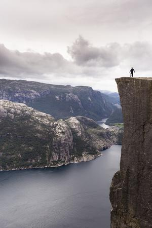 Preikestolen, Forsand, Ryfylke, Norway: A Single Man On The Pulpitrock Above Lysefjorden
