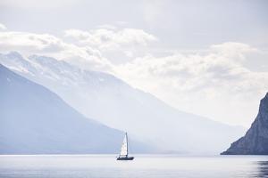 Riva Del Garda, Trento, Italy: A Sailing Boat On Lake Garda As Seen From Riva Del Garda by Axel Brunst