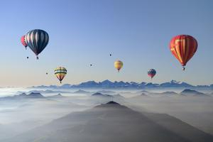 Hot Air Balloons over Mountain Skyline by Axel Lauerer