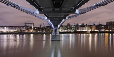 Millenium Bridge from Below, the Thames, at Night, London, England, Uk by Axel Schmies