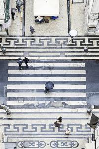 People with Umbrellas, Vertical View from the Elevador De Santa Justa, Lisbon by Axel Schmies