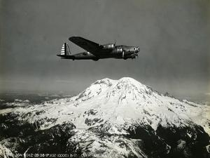 "B-17 ""Flying Fortess"" Bomber over Mt. Rainier, 1938"