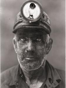 A close-up portrait of a coal miner. by B^ Anthony Stewart
