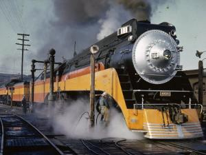 Man Fuels a Steam Locomotive at the Terminal by B^ Anthony Stewart