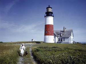 Sailor Walks a Dog Near Sankaty Head Lighthouse by B. Anthony Stewart