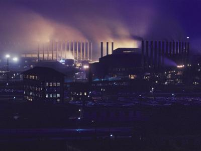 Smoke and Flame Rise Above the Mills of the United States Steel Corporation by B^ Anthony Stewart
