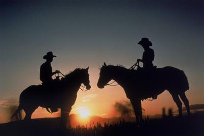 Silhouetted Cowboys