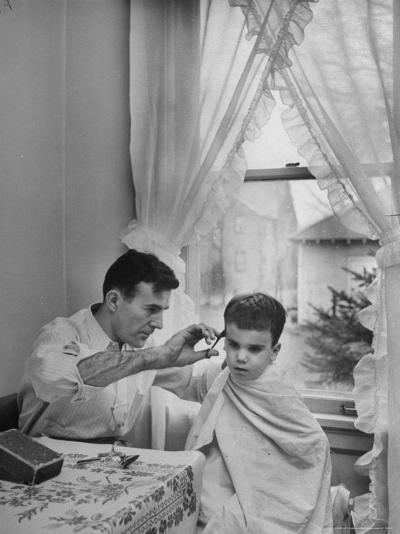 B.F. Goodrich Engineer Frank Herzegh Developed the Tubeless Tire, Cutting his son Frankie's hair-Alfred Eisenstaedt-Photographic Print