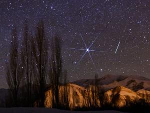 A Bright Meteor Streaks the Sky Near Sirius, the Brightest Star in the Night Sky by Babak Tafreshi